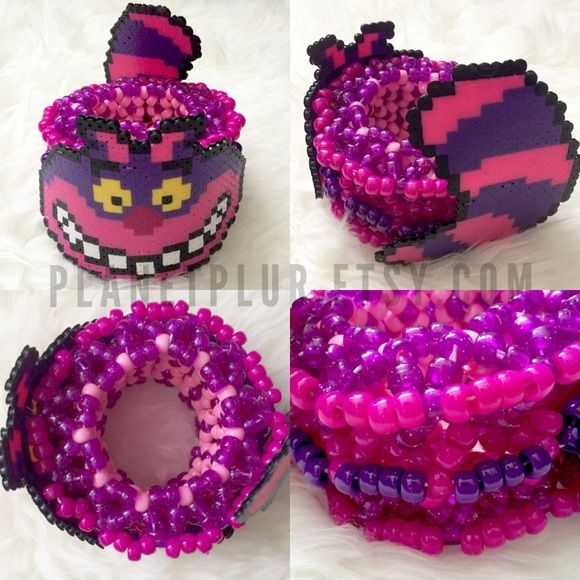 Kandi Cheshire Cat Epic 3D Cuff Rave EDM EDC EDM EDC RAVE KANDI Cheshire Cat Inspired Epic 3D Kandi Cuff Set Alice in Wonderland Kandi Cartoon Cheshire Cat Kandi Rave Gear EDM Wear Kandi Cat Ears EDC American Apparel Planet Plur Kandi ✨ Cheaper shipping & 20% off only on Planetplur.etsy.com ✨ ❌NO TRADES, NO EXCEPTIONS❌ This is a custom handmade piece by Brittany Rey. Colors and size can be changed. Comment if you have any questions! Follow for more coupons: IG: @PlanetPlurOfficial Facebook…