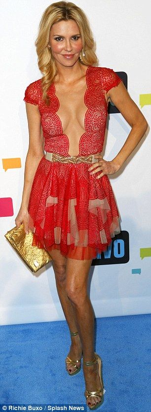 Skin on show: Brandi Glanville arrived at the Bravo Upfronts wearing a red dress with a plunging neckline