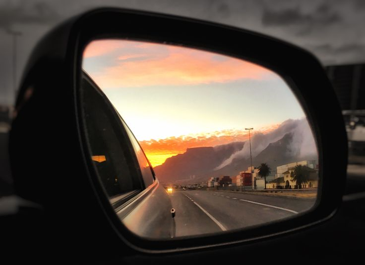 Table Mountain sunset in my rear view. #mountains #photography #sunset #capetown #summer #reflection #cars