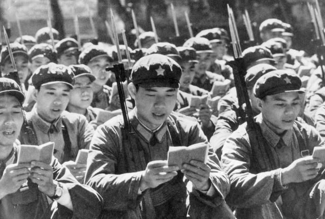 What Happened During China's Cultural Revolution?: Red Guards greet the morning with a mass reading of Mao's Little Red Book, 1968