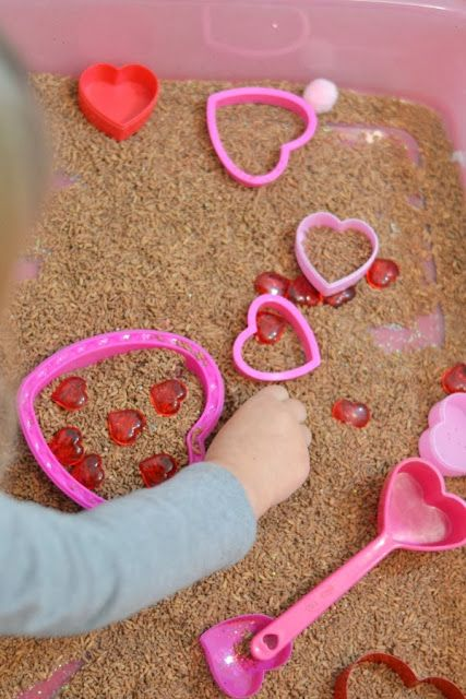 Valentines play with chocolate rice- this rice smells amazing & the aroma facilitates learning by stimulating brain function.  There are so many fun ways for kids to play and learn with this easy to make sensory material!