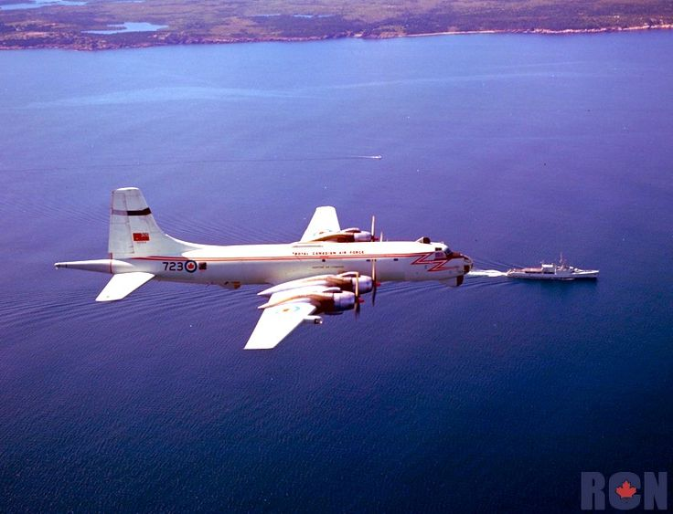 Airtoair CP107 Argus aircraft over water. RCN Destroyer