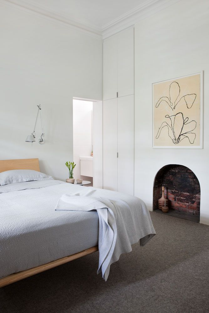 Robson Rak Architects + Made by Cohen // Armadale House // white; timber bed; fireplace; integrated wardrobe