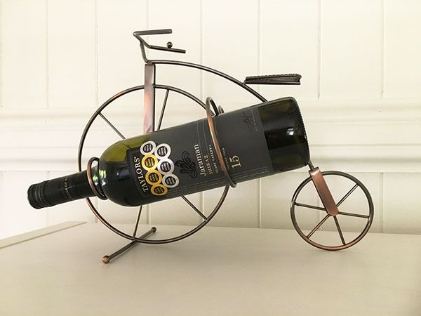 A Penny Farthing bicycle wine holder makes a unique centerpiece for any table and a fabulous gift for your cycling friends. A lovely metallic copper finish.