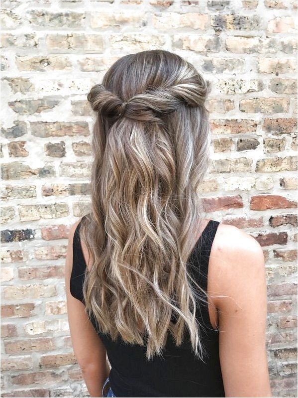 this gorgeous, half up half down, wavy hairstyle with a twisted crown looks great on medium to long hair lengths, but works for short hair styles as w