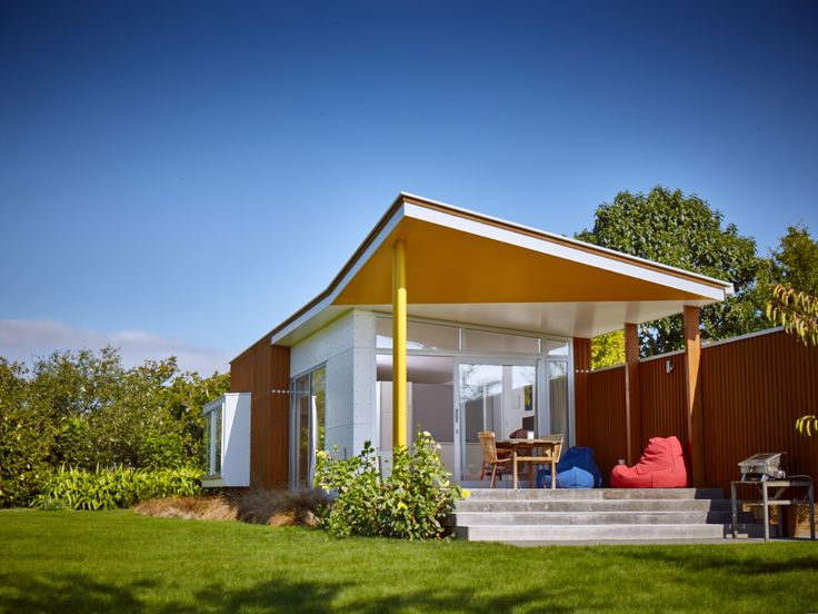 John's house pavilion, visitor accommodation in Hawkes Bay. The yellow angled roof section reflects the neighbouring John Scott house's red detail.