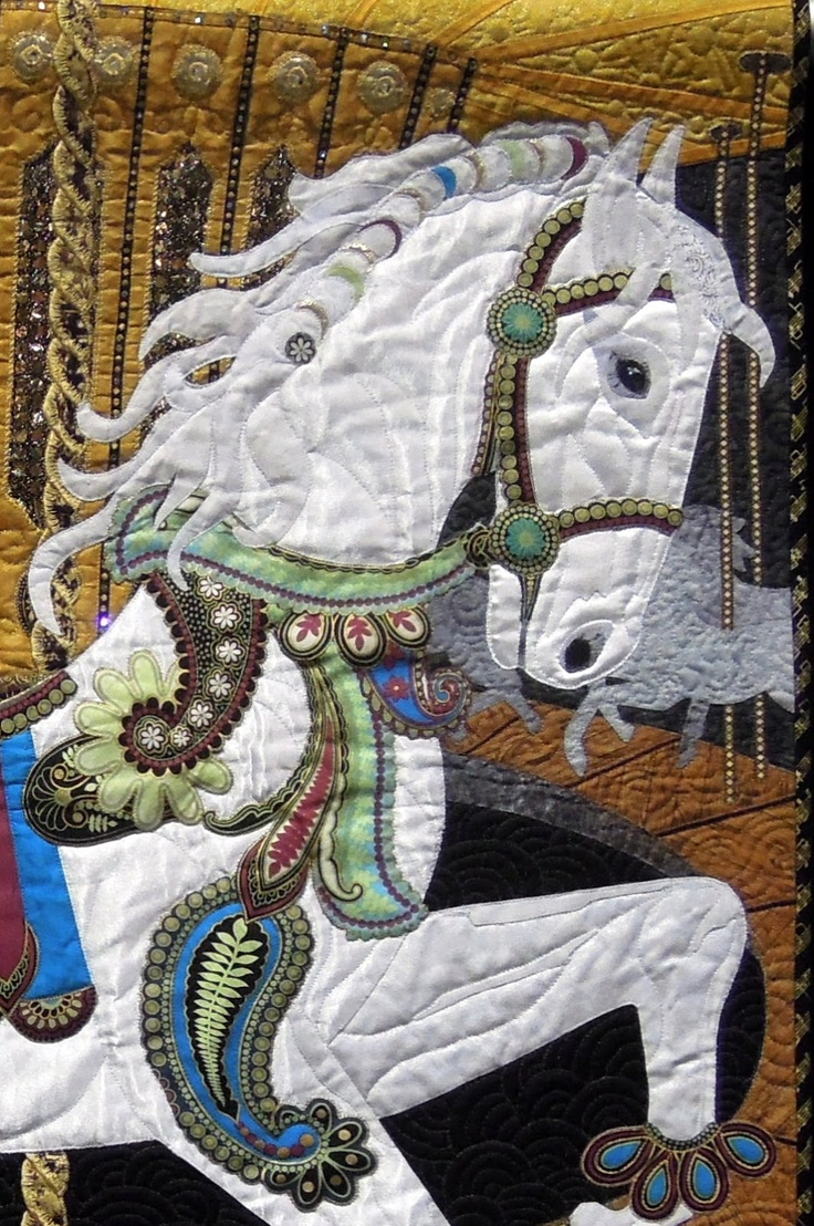 "Close-up of ""Ride With Me"" by Joanne Mitchell (New Zealand). An original design based on the early carousel horse of her childhood. Winner of the Hoffman Challenge; photo by Quilt Inspiration"