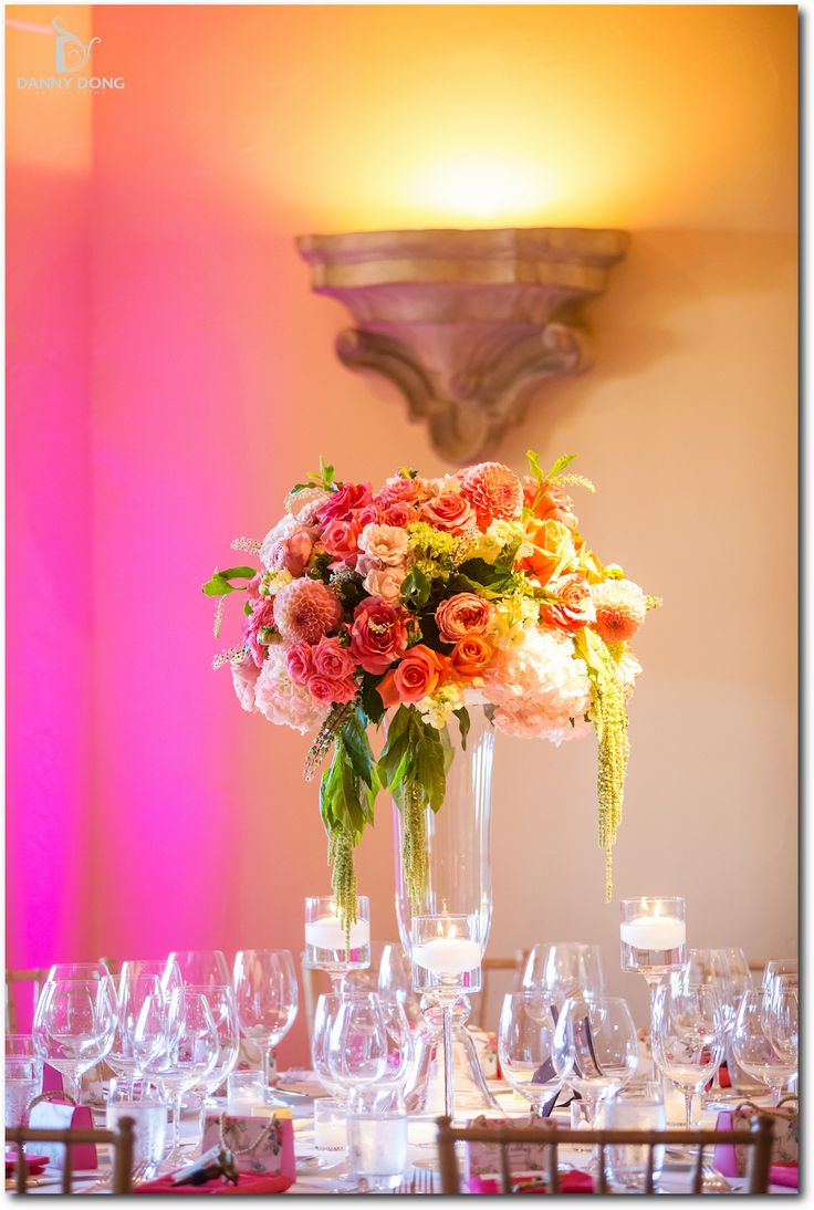 Romantic tall wedding centerpiece in coral pink yellow