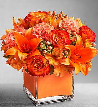 Orange Flowers  Centerpiece www.tablescapesbydesign.com https://www.facebook.com/pages/Tablescapes-By-Design/129811416695
