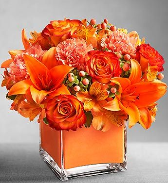 Orange Flowers  Centerpiece www.tablescapesbydesign.com https://www.facebook.com/pages/Tablescapes-By-Design/129811416695
