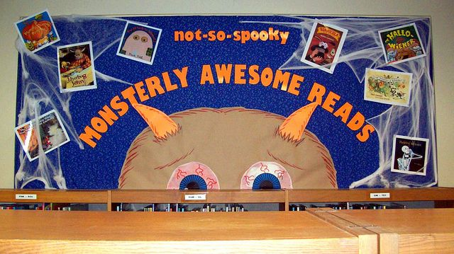 """""""Not-So-Spooky Monsterly Awesome Reads"""" library bulletin board: don't you love the giant monster head?"""