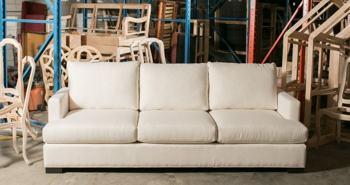 The T-seat and knife cushion back with top-stitching give this sofa a clean contemporary feel. Who wouldn't want to lounge here? Gresham House Furniture » 9103 or 4503