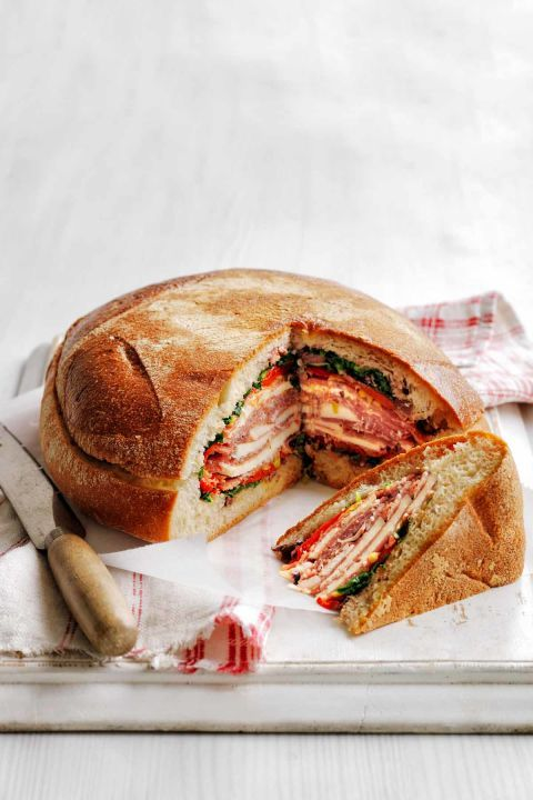 Pressed Italian Sandwich: This famous New Orleans sandwich, known as a muffuletta, allows the relish juices to soak into the bread, which makes it more delicious when you cut a slice. Click through to find more easy picnic food ideas to try this summer.