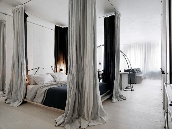 Not really a fan of canopy beds but love the drama of these black lined curtains.