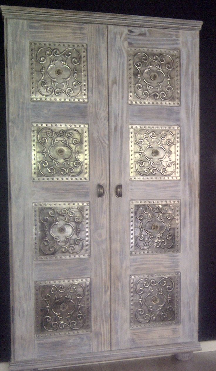 Cupboard designed and painted and then decorated with pewter by Lolita R