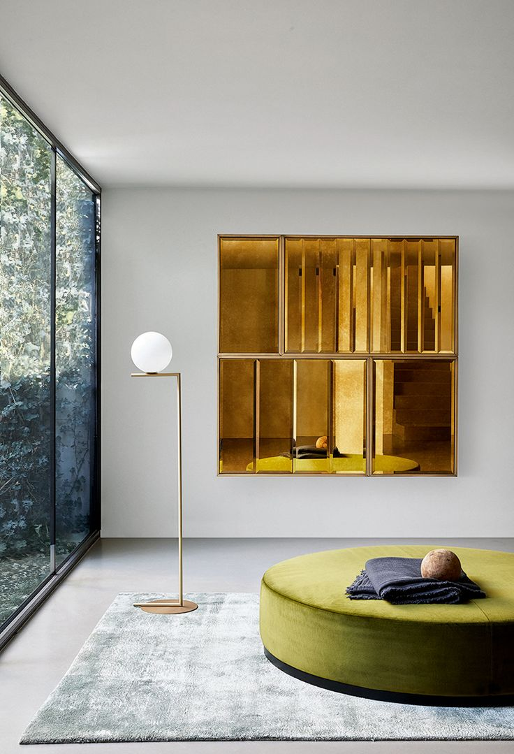 Wolfgang: geometric lines and antique bronzed beveled mirrors