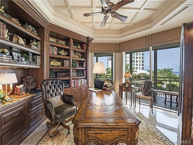 traditional formal home office built ins antique desk leather desk chair view of the gulf of mexico provence in park shore