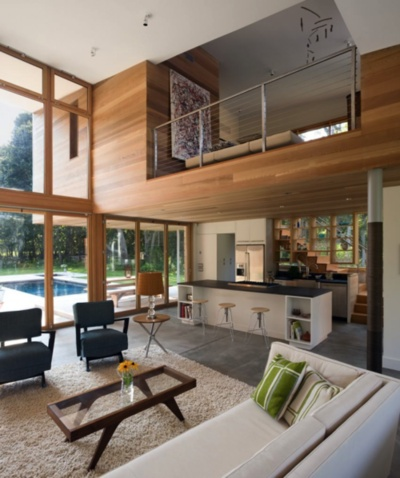 I like the layout of this great room. Love the wood panel walls and clean windows. Nice mix of wood and other materials.