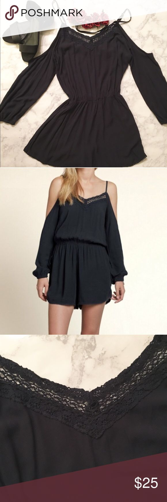 Hollister Cold Shoulder Romper *Large* Fun, boho cold-shoulder romper with crochet v-neck and pom pom detail on the shorts. True color is dark navy, but looks black. Only worn once. No trades please. Thanks! Hollister Pants Jumpsuits & Rompers
