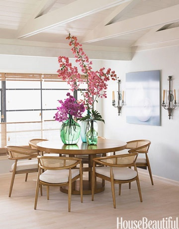 """A Dining Room Inspired by the Beach: Chris Barrett designed the 1950s-style dining room table and chairs; she caned the chairs and made a see-through table base to give the furniture a """"beachy"""" feel."""