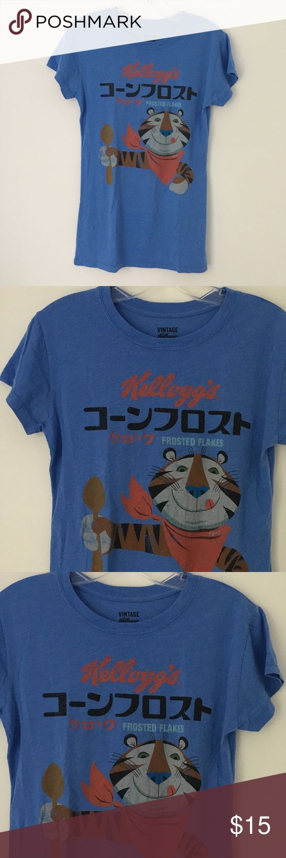 "RARE CUTE FROSTED FLAKES CEREAL PROMO TEE SHIRT !! Tags: Awesome Unique Unusual RARE 2010 Kellogg's Frosted Flakes Made In Thailand Distressed Vintage Faded Style Graphic Design Pattern Print Tony the Tiger Breakfast Cereal Promo SOFT Tee Shirt Top.  Brand new. Never used. NO flaws.  Size: Tagged YOUTH Large, will fit women's XS or Small.  Measurements: Chest- 16"" across • Length- 26.5"" long.  •Smoke-free + Pet-friendly (dogs) facility. •NO holds, returns or refunds allowed. •The price is…"