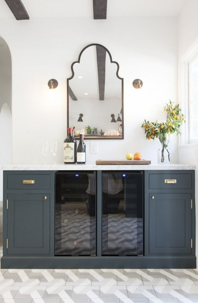 Cabinets, mirror and sconces