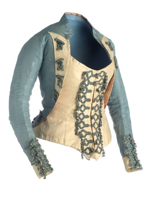 Jubon - Vest, ca. 1770, Madrid. Blue silk and taffeta silk in ivory. With neck placket and long sleeves and narrow. The back ends in its lower edge in a queue. Decorated with a silk cord application and metallic threads in gold silk braid. Majismo costume, part of the movement in late 18thC Spanish clothing away from the influence of the French and towards a more Spanish style of clothing. (c) Museo del Traje