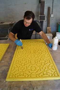 Applying release to a lattice form before filling it with GFRC mix and warping it.