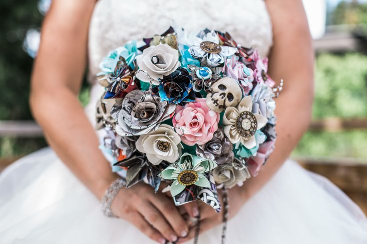 Rock & Roll Wedding inspiration theme. Wedding ceremony at humber arboretum in Toronto.Skull bouquet. Hand made bouquet.