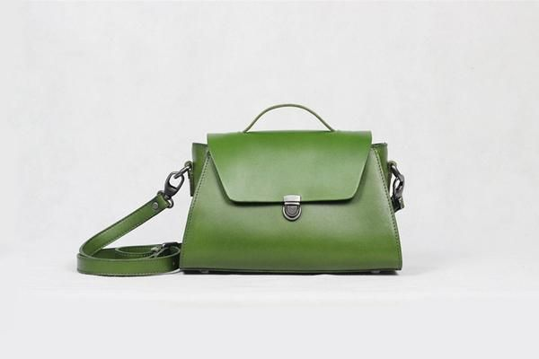 Handmade Genuine Leather Tote Bag Messenger Shoulder Lady Bag We use genuine cow leather, quality hardware and nylon fabric to make the bag as good as it is.   •Adjustable shoulder strap. •Open top zipper closure. •Brass hardware   •Length: 25.5cm; Height: 17cm; Width: 12cm; •Color:Green