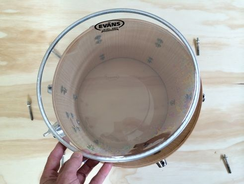 A tutorial on how to replace a drum head. Fitting a new drum head to a shell.