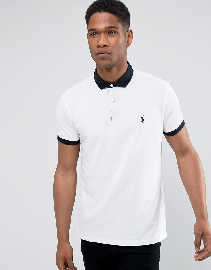 Get this Polo Ralph Lauren's polo shirt now! Click for more details. Worldwide shipping. Polo Ralph Lauren Pique Polo Slim Fit Contrast Woven Collar in White - White: Polo shirt by Polo Ralph Lauren, Breathable cotton pique, Polo collar, Button placket, Embroidered Polo Player logo, Split sides for ease of movement, Fitted cuffs, Slim fit - cut close to the body, Machine wash, 100% Cotton, Our model wears a size Medium and is 185.5cm/6'1 tall. Naming his brand after a game that embodies…