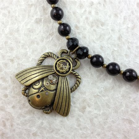 Steampunk Inspired Bug Pendant on Black Glass Necklace