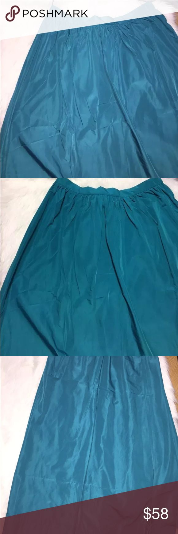 Eloquii teal maxi skirt with pockets New Eloquii teal maxi skirt with pockets and elastic waistband. 100% polyester. 19 inch waist and 43 inches long. Eloquii Skirts Maxi