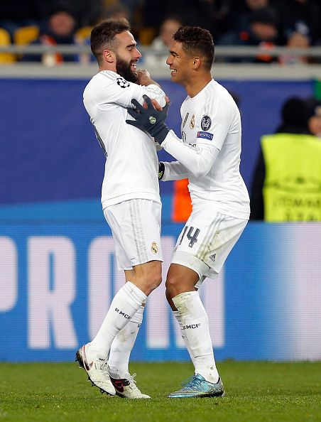 Dani Carvajal and Casemiro of Real Madrid celebrate after scoring during the UEFA Champions League Group A match between FC Shakhtar Donetsk and Real...