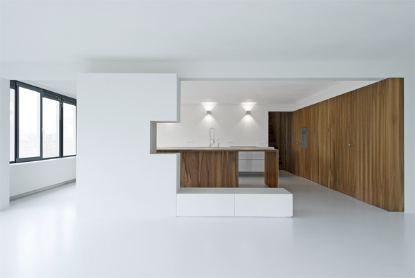 Interior of the Kaan House by Claus en Kaan Architecten. Photo by Dutch photographer Sebastian van Damme. All-white interior with beautiful acccents walnut wood.