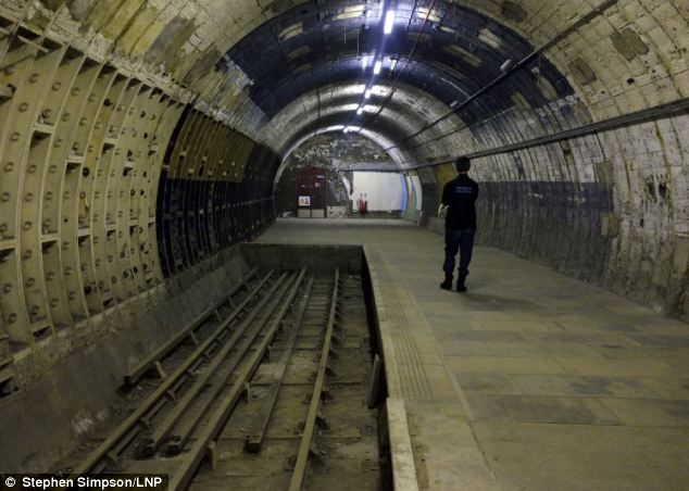 A secret disused underground station was used by thousands of Londoners during the Blitz.. Aldwych Tube Station, one of London's closed underground stations, which included a platform stopped operating in 1914. The disused station which was used during the Blitz. The tracks were laid before the introduction of suicide pits common on tube lines today