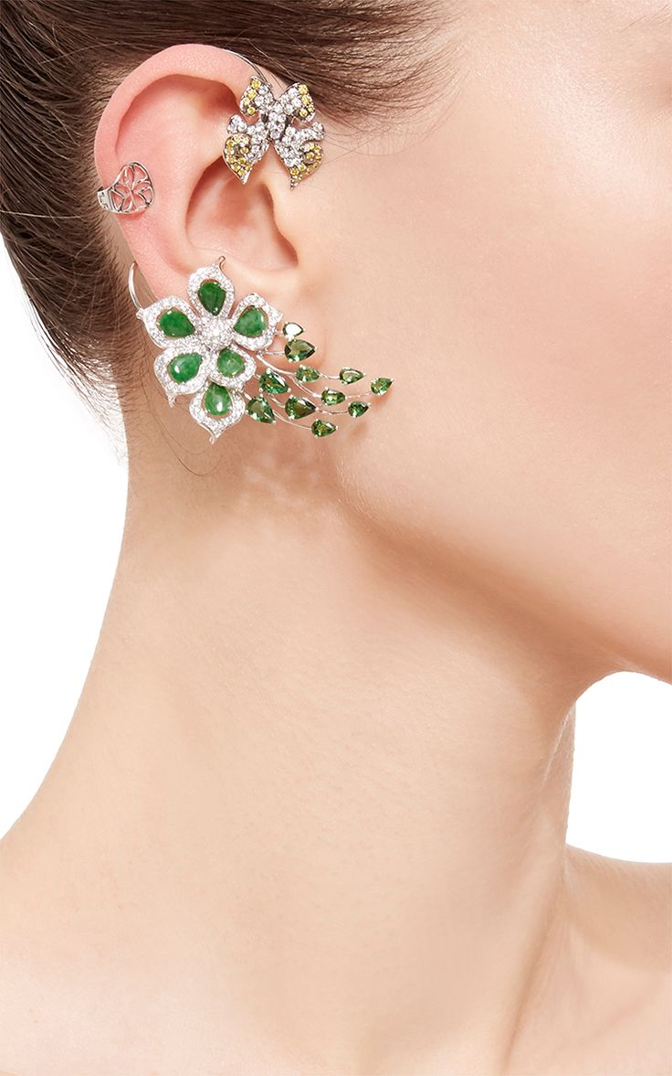 Butterfly In Flower Ear Cuff by Wendy Yue for Preorder on Moda Operandi. his statement earcuff by Wendy Yue embodies her infinite fascination in nature, by featuring a whimsical construction formed by an intricate floral design accompaigned by a flying butterfly in white and golden diamonds. Slip On 74 White Diamonds, 0.67ct 89 White Diamonds, 1.515ct 8 Golden Diamonds, 0.415ct 7 Tsavorite, 1.27ct 4 Tsavorites, 1.43ct 6 Jades, 1.275ct