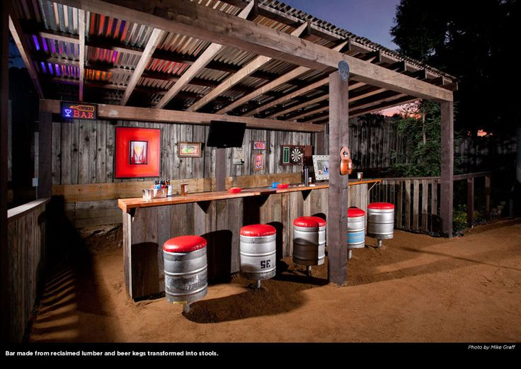 rustic backyard bar with kegs refashioned as bar stools