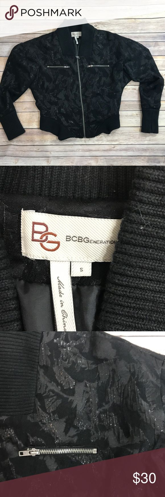 BCBGeneration bomber  jacket Black jacket with jacquard and shimmer detail. Stretchy cuffs and waistband.  Zipper pockets. With silver hardware. 19 inches long. offers welcome. BCBGeneration Jackets & Coats