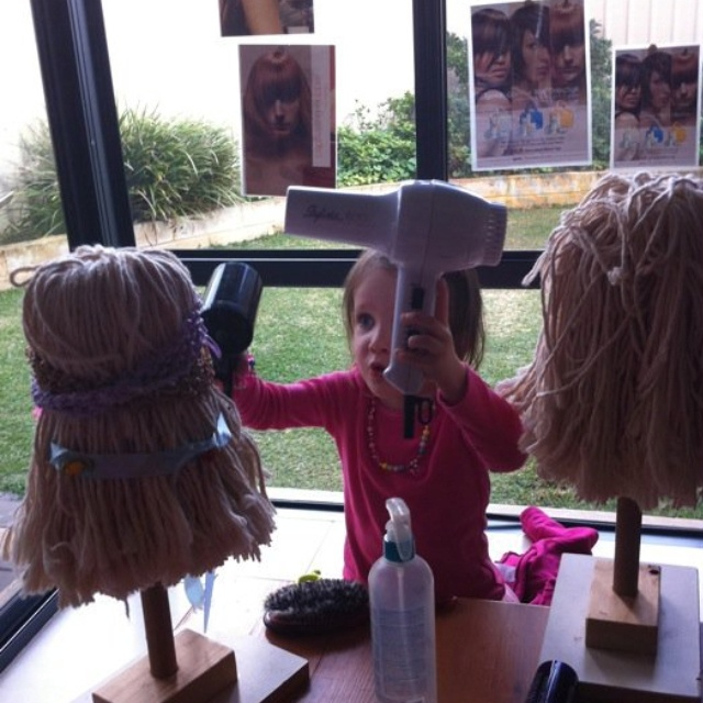 """Kids Hair Salon~  using new mop heads attached to a wooden base.  Add lots of hair accessories, water spray bottles, combs, pretend hair dryers, You can even dye the mops """"hair"""" using food coloring added to water in a spray bottle. Etc.....So much fun!"""