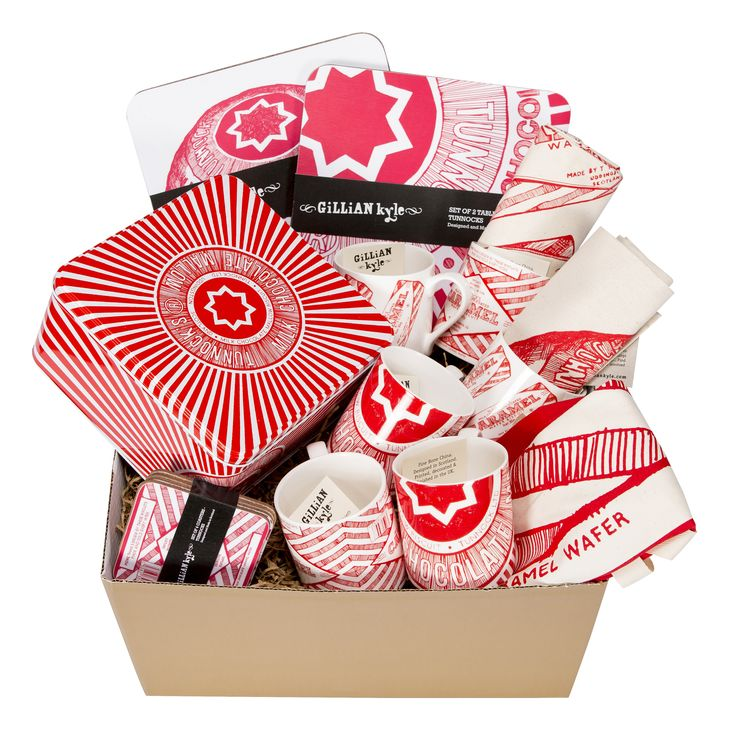 This is the ultimate gift for Tunnock's lovers everywhere! Choc full of delicious kitchen textiles, mugs, placemats, coasters and a funky biscuit tin from our bestselling and iconic Tunnock's range. All packed up in a gorgeous gold hamper box.  Would make a fantastic and mega-easy housewarming, wedding, retirement, anniversary or leaving gift.