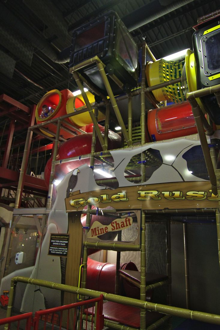 Adventure Park USA - The 17.5-acre Western-themed facility consists of a 22,000-square-foot building with an arcade of 85 redemp¬tion and video games from Central Vending, a custom-made International Play Company of Canada soft play indoor playground called Gold Rush.