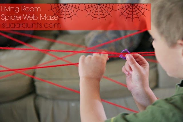 Create an indoor spider web with yarn.  Gross motor play with an added twist to address fine motor skills, bilateral hand coordination, motor planning, and visual scanning.