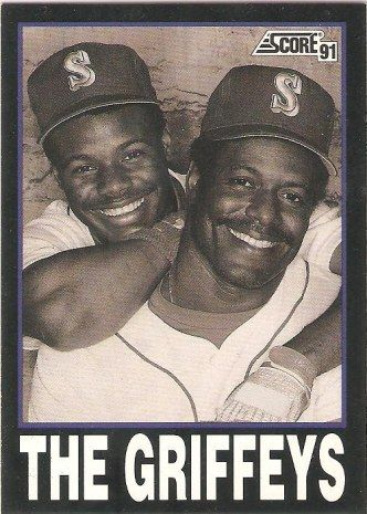 Score baseball card of father and son baseball players Ken Griffey Sr. and Ken Griffey Jr., who both played for the Seattle Mariners.