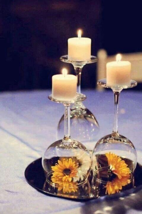 Table decoration with upside down wine classes. Different classes, flowers, pebbles, etc make an impression