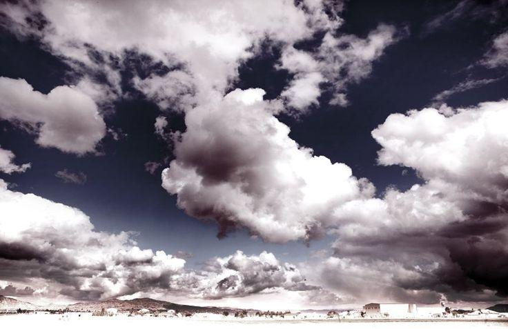 Les Nuages By, Alex Remington  Description: Les Nuages is plural for cloud in French.  These beautiful clouds were photographed in Palm Springs, CA.  The small horizon line enhances the enormity of the cloud formations, and the shadows on the mountains add depth.