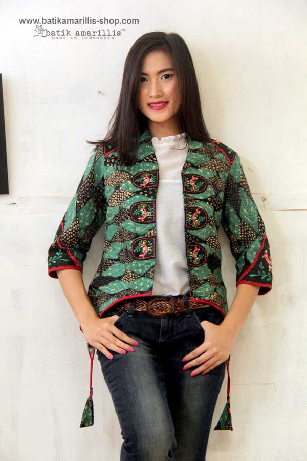 Batik Amarillis's Arcana jacket in classic hand drawn batik Pemalang with hungarian embroidery ...Stand out in the crowd with this unique and stunning military cropped inspired jacket,this contemporary and yet vintage style is accented with exquisite embroidery on the shoulders epaulettes ,sleeves & chest adornments also features our triangle arcana tassels to complete the whole extravangant work of art!.