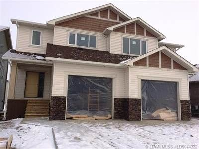 Brand New - Full Duplex - Fully Developed - Separate Titles! Each unit features Stainless Steel appliances, 4 large bedrooms, 3.5 baths, 2 family rooms, vaulted master bedroom with 3 pce. bath, second level laundry, wind protected deck, with gas line for BBQ, nice sized yard, quality finishings throughout and a super single attached garage. Each 1/2 Offered at $295,000.00 per door!