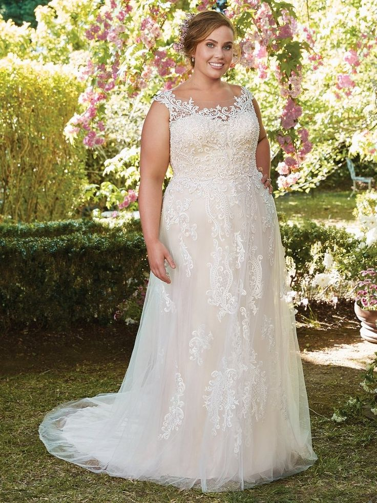 ALEXIS - Rebecca Ingram. This flirty A-line gown features distinctive crosshatch motifs embellished with Swarovski crystals, delicate beading, and sequins. Illusion details accented in lace appliqués create beautiful back interest. Finished with covered buttons over zipper closure.